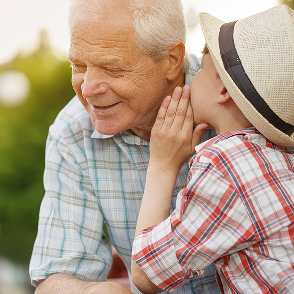 boy and grandfather listening